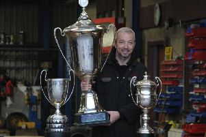 Gordon Moodie with the World, World Cup and Scottish Championship trophies.