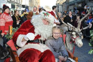 Santa, pictured here with last year's winner Lyla Steel (then aged 7), returns to Kirkcaldy with his reindeer for Sunday's parade.  Pic: George McLuskie.