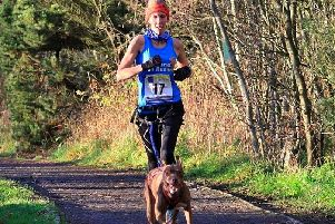 Falkland Trail Runners: Louise Lessells and dog Jem who were among the prizes in the Lochore Meadows Canicross event