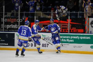 Flyers players celebrate (Pic: Jillian McFaralane/EIHL)