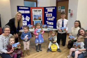Linlithgow Academy students at St. Michael's Toddler Group to give children their book - Harris the Haggis - Adventures in Edinburgh.