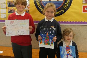 Poppy (centre) with runner ups Finlay Carry and Aurla Leifer