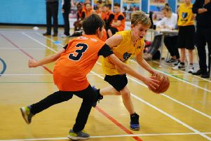 06-12-2019. Picture Michael Gillen. GRANGEMOUTH. Abbots Road. Grangemouth Sports Complex. Junior NBA finals. Game one court one Bonnybridge (yellow) v St Margaret's (orange) Dunfermline.