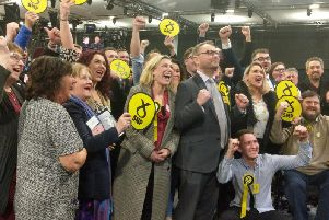 Richard Thomson and his campaign team celebrate the SNP victory.