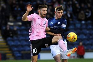Jamie Watson challenges Peterhead's Jack Leitch - credit- Fife Photo Agency