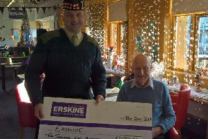 Sergeant Major Lee Penrice presents a cheque to 104 -year-old RAF veteran John Haswell Young, a resident of the Erkine home in Bishopton