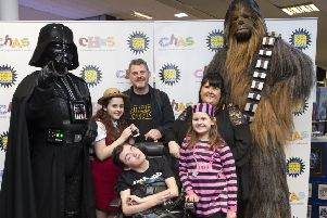 Lynne, Gary and thei family including Adam with Star Wars characters at last year's Capital Sci-Fi event. Pic: Lesley Martin.