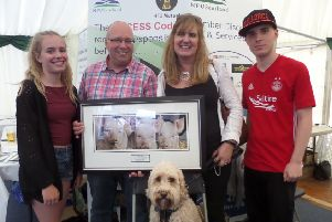 Celebrating his Unsung Hero award at Turriff Show was well known pig producer Kevin Gilbert (centre) accompanied by his wife Anna, daughter Elizabeth and son Thomas. Even Jazzer the family dog joined in the celebrations.