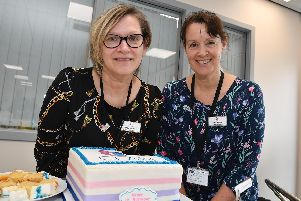 Celebrating the birthday are Angie Howarth (left), area support services co-ordinator and Karen Fulton, local support co-ordinator.