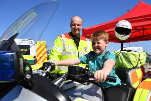 Alfie Gillanders from Peterhead sits on the blood transfusion bike watched by Mike Steen
