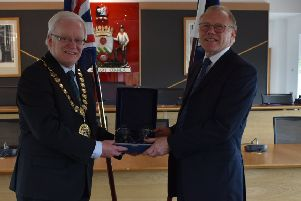 Willie Taylor from Milngavie is honoured for his 20 years of service to the Children's Panel by East Dunbartonshire depute provost Gary Pews