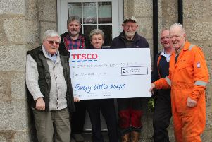 Strichen Community Park members with their cheque from Tesco.
