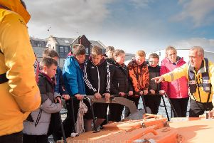 Youngsters get shown around the Broch lifeboat during their visit to the station.