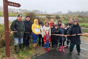 Despite the inclement weather, a small crowd gathered to see the footpath officially opened.