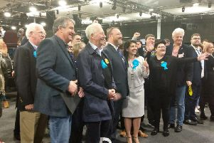 David Duguid (centre) and his team celebrate his victory in Banff and Buchan.