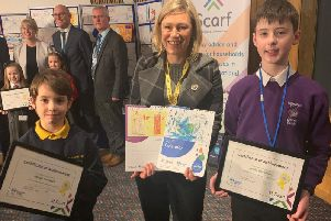 Gillian Martin MSP with Aston Howarth and Sandy Davidson and their winning designs.