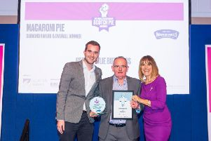 Hebbie Fowlie is presented with his award from Carol Smillie.