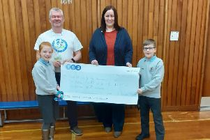 Islay Northeast and Ryan Finnie hand over the cheque to Jim and Kate from the SCAA.