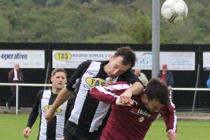 Saturday 3rd September'Threave Rovers v linlithgow Rose'Threave's No.5 Scott Wilby out jumps Linlithgow's No.10 Thomas Coyne