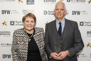 Margaret Simpson and David Ward collecting the prize for best social enterprise at this year's Scottish Borders Business Excellence Awards.