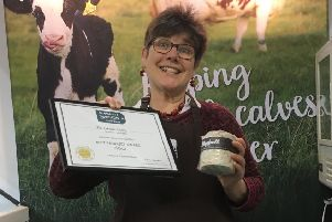 Director Wilma Finlay with The Ethical Dairy's award for its Bluebell cheese.