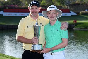 Stephen Gallacher poses with his son and the trophy after he wins the final round on day four of the Hero Indian Open at the DLF Golf & Country Club on March 31, 2019 in New Delhi, India. (Photo by Ross Kinnaird/Getty Images)