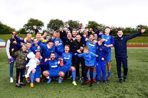 Delighted Carluke Rovers manager Derek Wilson and his players celebrate clinching promotion after Saturdays win (Pic by Billy Quigley)