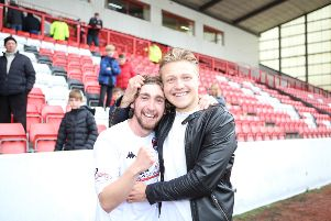 Ray Grant is congratulated by brother Peter after Clyde's promotion win. Picture Craig Black