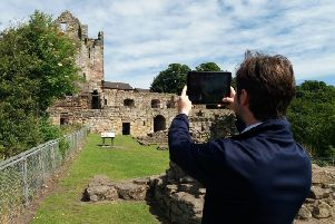 John Murray demonstrates the app at Ravenscraig Castle