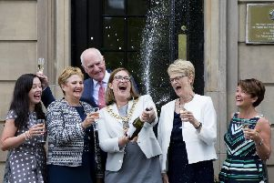 Ashley Thomson, fundraising manager; Rhona Baillie, chief executive; Charles Berry, chairman of the hospice's capital appeal group; Lord Provost Eva Bollander; Maureen Henderson, Hospice chairman; and Heather Manson, fundraising director, celebrate on the steps of the hospice. (Photograph by Martin Shields)