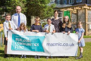 Jamie McLean and Susan Wilson of Mactaggart & Mickel Homes pictured with Eaglesham Primary School pupils (L-R) Nathan Clough P6, Jessica Marchant P2, Matthew McVey P5, Milla Perry P6, Niamh Moore P7 and  Isla Wilson P3.