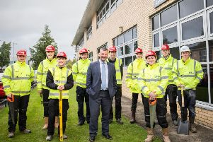 Mark Bryden (fourth left), with Bryan Galloway, construction director for Stewart Milne Homes, and the other new apprentices.