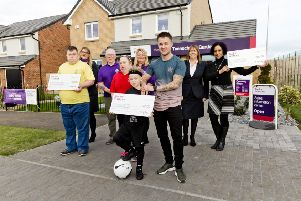 The three Community Chest winners from Viewpark receive their cheques at Taylor Wimpey's Tannochside Gardens development