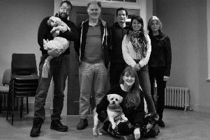 From left: Director Michael Emans with The Twelve Pound Look cast members Tom Hodgkins, Steven Scott Fitzgerald, Jo Freer and Julia Watson, with designer Lyn McAndrew (on floor) and dogs Benji and Teddy.