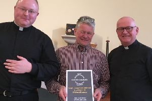 Pictured from left: Father Jonathon, Russell Macmillan, Father Stephen from Saint Joseph's church in Clarkston