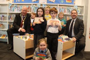 Provost Jim Fletcher and Councillor Paul O'Kane with local school pupils.