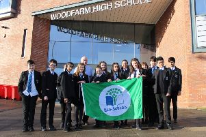 Proudly pictured with their new flag are Woodfarm High School pupils who have been heavily involved in the schools extensive eco-work.