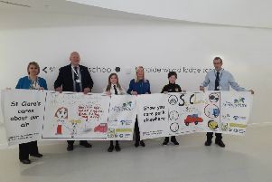 From left: East Renfrewshire Council's Environmental Health Officer, Kirsten Walsh, East Renfrewshire Council Convener for Environment, Councillor Alan Lafferty, Primary 7 pupil, Cecily Coffey Craig, St Clare's Primary Head Teacher Anne-Marie Absolom, Primary 6 pupil, Rocco Watters and East Renfrewshire Council Environmental Health Officer, Richard Mowat.