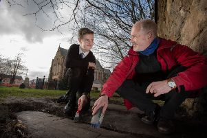Mark McGettigan, who found the stones is pictured with Professor Stephen Driscoll, Professor of Historical Archaeology at the University of Glasgow. (Photo: Martin Shields)