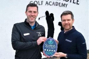 Russell Gray (left), operations manager at Mearns Castle Golf Academy, accepts the Quality Assurance Five star accolade from Gordon Smith, VisitScotland regional director.  (Photo:VisitScotland)