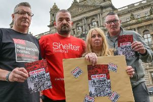 A delegation of previously homeless people deliver a copy of a lawyer's letter to Glasgow City Council.