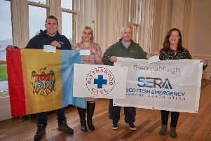 Ian Murray and Charlie Nicolson accepted the cheque on behalf of Moldova & SERA Projects.  Bethesda's cheque was collected by Natalie Keillor, Fundraiser, and Catherine Janice Gomez, Bethesda Shop Manager.