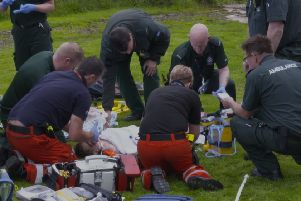 Paramedics treat Felix in  Eaglesham. (Photo: BBC Scotland).