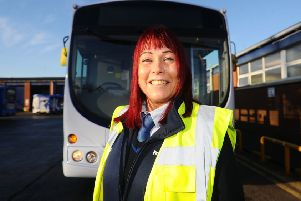 First driver Pamela McCluskey says she's no hero, despite helping residents to flee from a fire. Picture: Michael Gillen