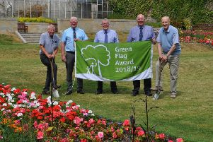 From left, Alex Bell of Hawick in Bloom, councillors Stuart Marshall, George Turnbull and Watson McAteer and Jake Coltman of Hawick in Bloom in the town's Wilton Lodge Park celebrating as it claims Green Flag status.