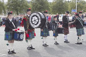 Drummers line up to deliver their drums to be made into an alter.