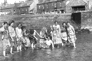 Archive photo of ladies paddling in the river Teviot, Hawick.