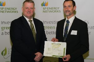 Hawick community councillor Andy Maybury, right, being given �107,000 by SP Energy Networks chief executive officer Frank Mitchell in Glasgow last November to help get the town's electric car club started.