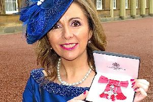 Carluke's Gill Murray with her MBE for her charity fundraising..