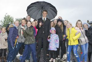 Hawick Cornet Connor Brunton with youngsters ready for the walk around the town.